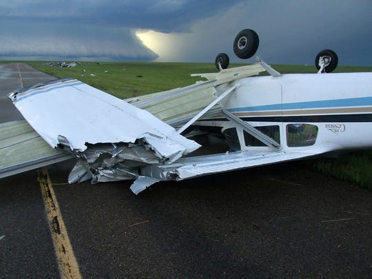 The storm tossed a 175 Cessna plane upside down at the airport in Plentywood.