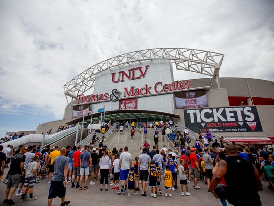 Fans rush into the Thomas and Mack Center on Saturday during the second day of NBA Summer League in Las Vegas.