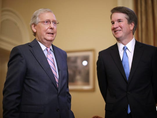 Senate Majority Leader Mitch McConnell, left, makes brief remarks before meeting with Judge Brett Kavanaugh, right, in McConnell's office in the US Capitol, in Washington on July 10, 2018.