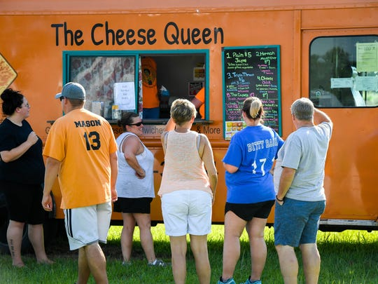 Diners lineup in front of The Cheese Queen food truck