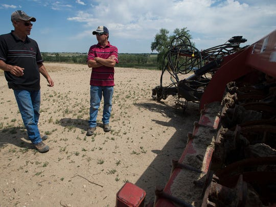 Longmont farmers Paul and Scott Schlagel show some
