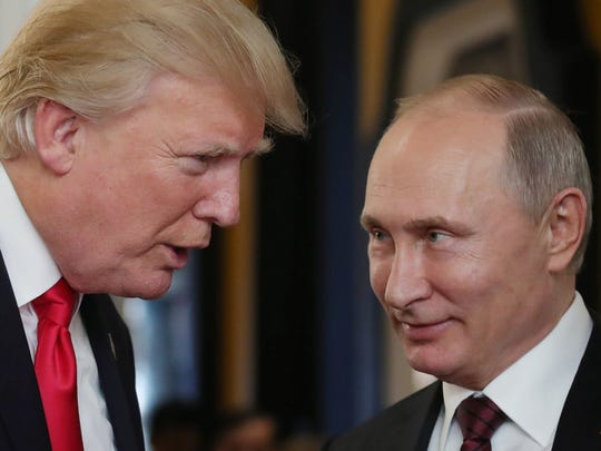 US President Donald Trump (L) chats with Russia's President