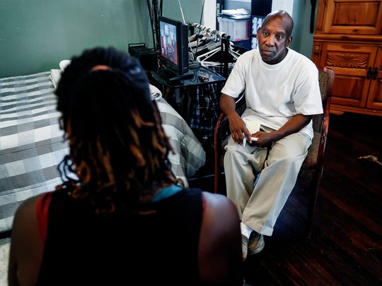 Constance Abbey's Alcohol and Drug Counselor Hakim Israel (right) listens to a homeless woman as she talks about her history of living on the streets of Memphis.