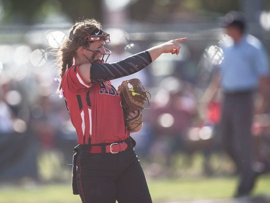 ADM's Abbie Hlas points to a teammate in the outfield during the Class 4A state softball championship between ADM and Des Moines Hoover on Friday, July 20, 2018, at the Rogers Sports Complex in Fort Dodge.