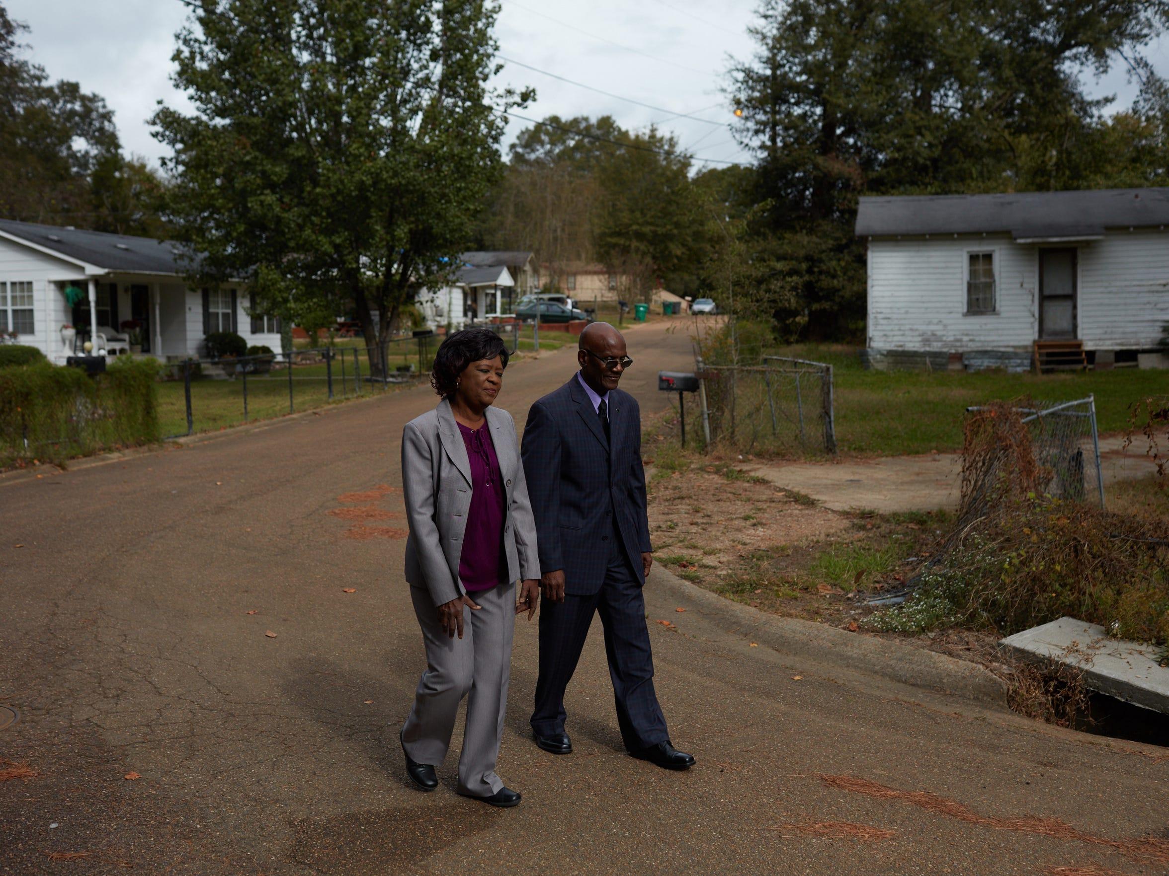 Lola and Archie Flowers walking in their Winona neighborhood