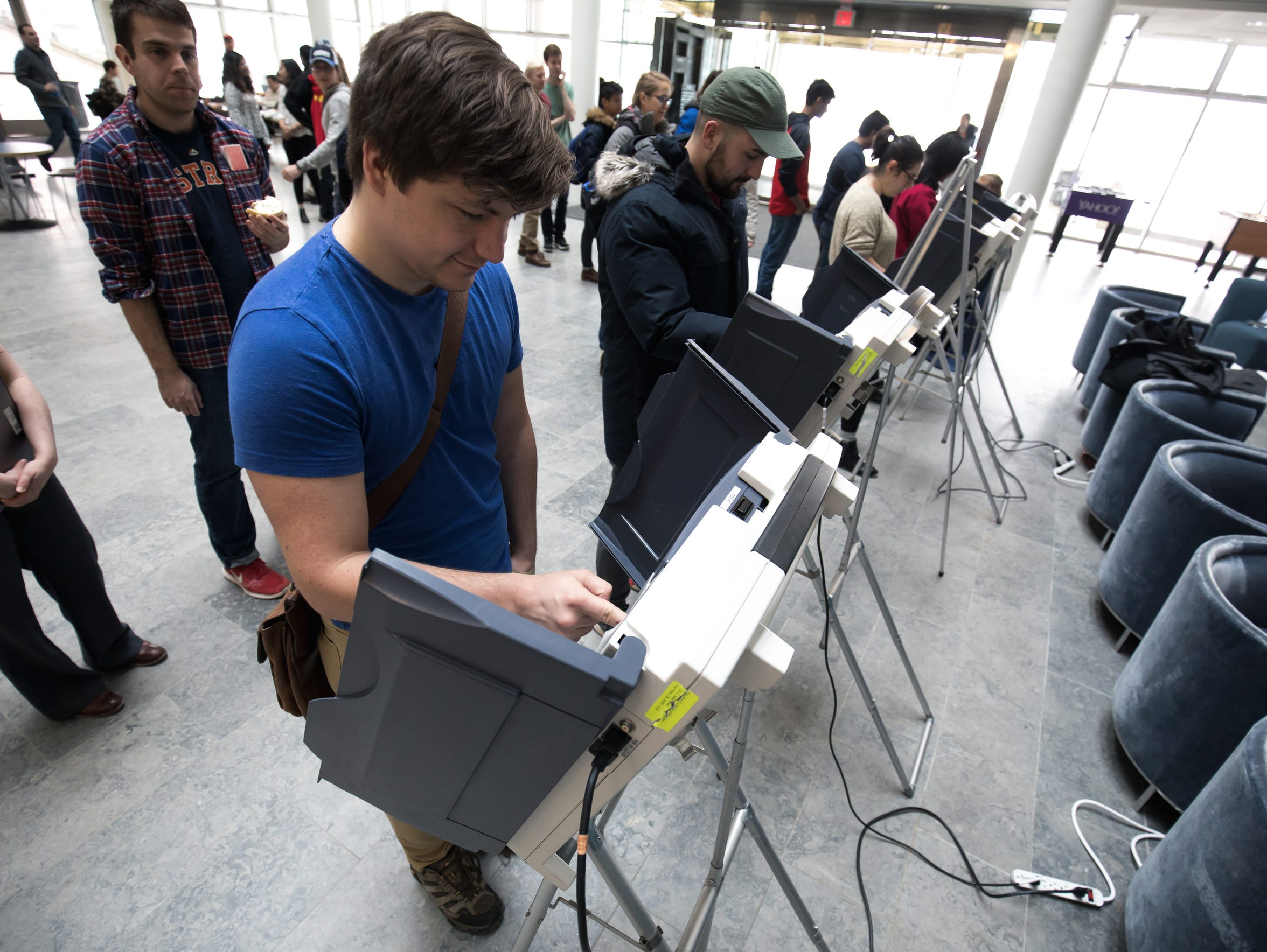 Students participate in a voting demonstration at the