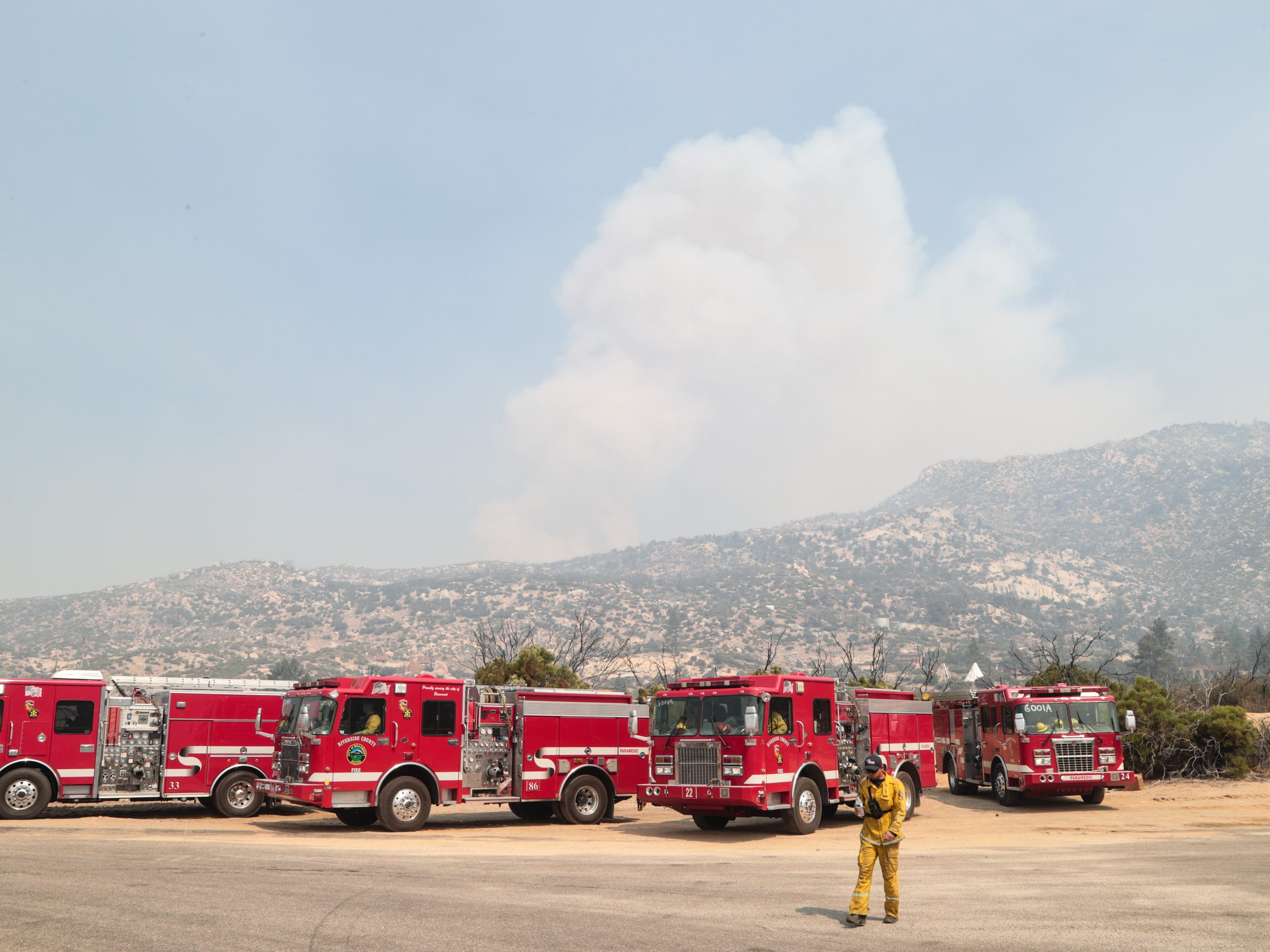 Cal Fire Firefighters watch the spread of the Cranston Fire along Apple Canyon Road, Friday, July 27, 2018.