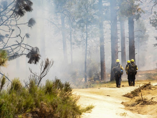 Firefighters put out hot spots along Apple Canyon Road