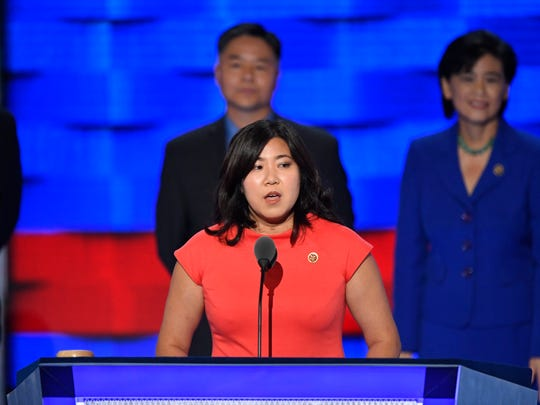 Rep. Grace Meng, D-N.Y., speaks as she stands with