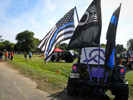"""Jeeps line up to run the off-road course at the """"Cops"""
