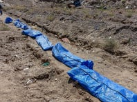 Syrians recover remains of loved ones buried at zoo