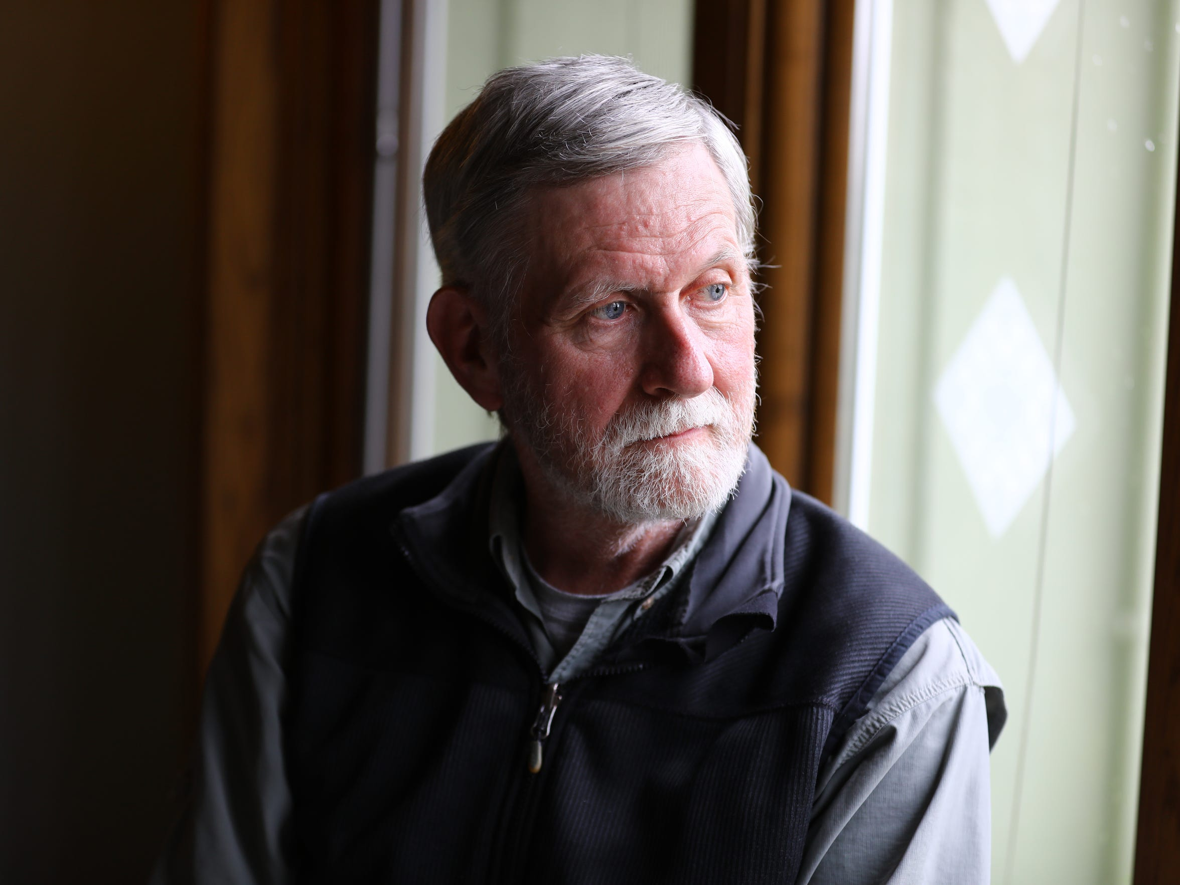 "Robert Rolley, a retired Wisconsin Department of Natural Resources wildlife research biologist, says he has seen regular citizens lose influence over natural resource decisions. He is seen here at his home in Baraboo in May. ""There is a long history in the DNR of listening to public input prior to making management decisions,"" says Rolley, who worked at the agency for 25 years. ""What has changed is which citizens the DNR Board and administration is interested in listening to."""