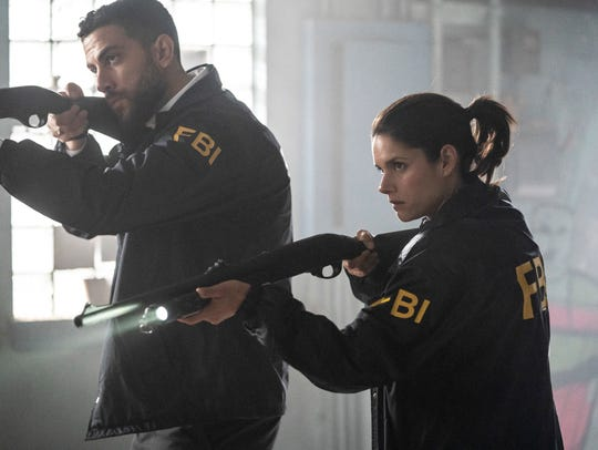 Zeeko Zaki, left, and Missy Peregrym play FBI special