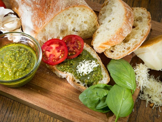 Fresh basil, pine nuts, garlic and olive oil are the