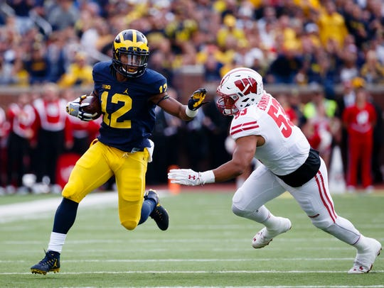 Wisconsin Badgers linebacker T.J. Edwards chases Michigan