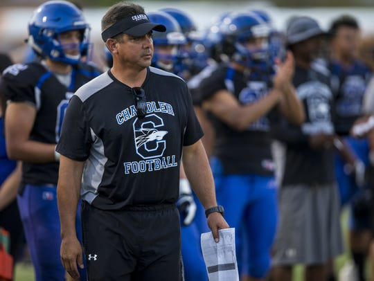 Chandler head coach Shaun Aguano watches during a scrimmage