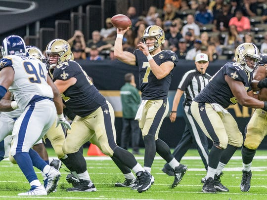Saints backup quarterback Taysom Hill throws a pass during the Nov. 4 game against the Los Angeles Rams in New Orleans.