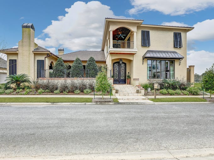 This 6 bedroom, 5 2 1/2 bath home is located at403