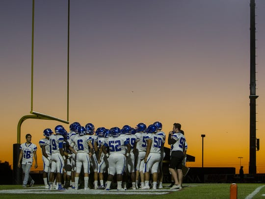 Dobson players huddle before a game against Red Mountain