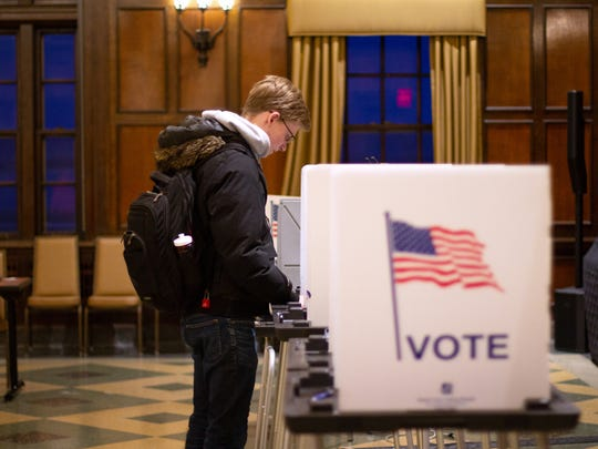 "Ethan Carpenter, a sophomore at the University of Wisconsin-Madison, votes in the Madison city primary at the Memorial Union on Feb. 19, 2019. ""I'm very thankful that the people around me and my parents helped me know that this (voting) was important,"" Carpenter said. ""Here on the local level, we students can make the greatest change."""