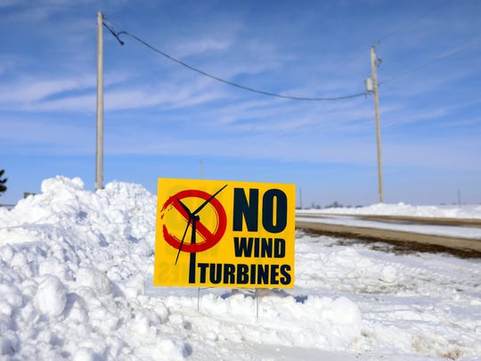 "A sign that reads ""No Wind Turbines"" sits in Jim Bauman's"