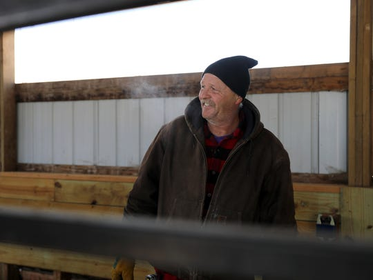 Micah Bahr is seen on his farm in the town of Kendall on Feb. 15. He says he has gotten headaches from nearby wind turbines and is opposed to proposed wind projects coming to southern Wisconsin.