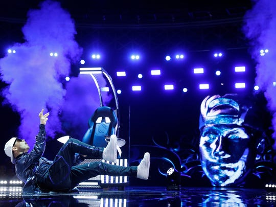 "Farmington native John Austin, a.k.a. Poppin John, competes during Sunday's Division Finals on NBC-TV's ""World of Dance."""