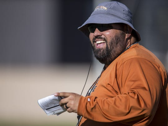 Desert Edge head coach Jose Lucero laughs during spring practice on Tuesday, May 7, 2019, at Desert Edge High School in Goodyear, Ariz.
