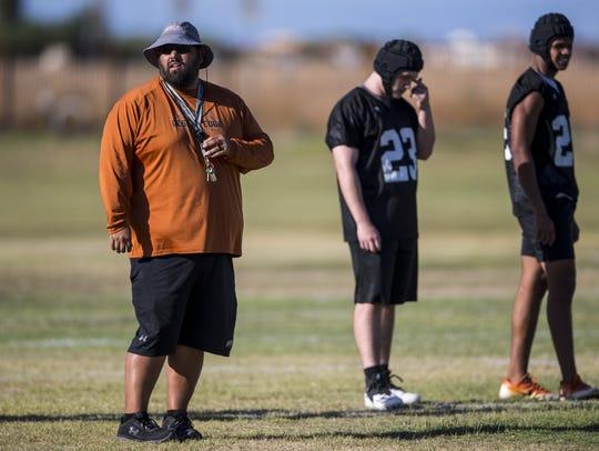 Desert Edge head coach Jose Lucero watches drills during