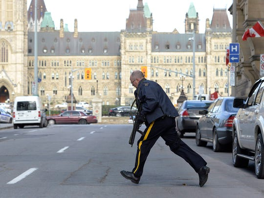 Police secure an area around Parliament Hill in Ottawa on Wednesday Oct. 22, 2014.