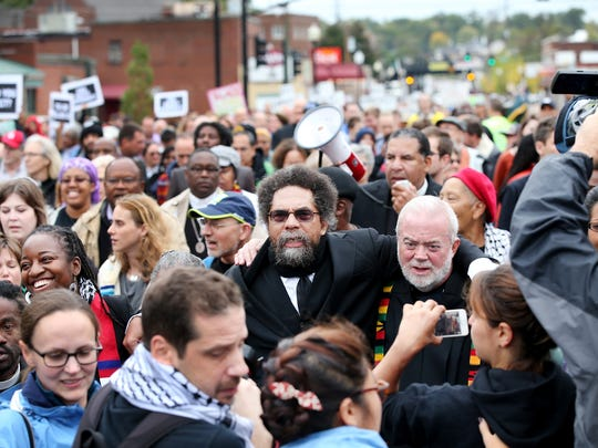 Author and activist Cornel West (center), members of the clergy and other demonstrators protest outside the Ferguson police station on October 13, 2014 in Ferguson, Missouri. Ferguson has been struggling to heal since riots erupted following the Aug. 9 killing of 18-year-old Michael Brown by a police officer in suburban Ferguson. Another teenager, Vonderrit Myers Jr., was killed by a St. Louis police officer on Octo. 8.