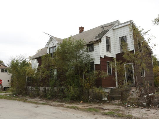A home sits abandoned Oct. 21, 2014, in the 2200 block of Massachusetts Street in Gary. Police said Darren Deon Vann, 43, allegedly left the body of an unidentified African American woman at this location.