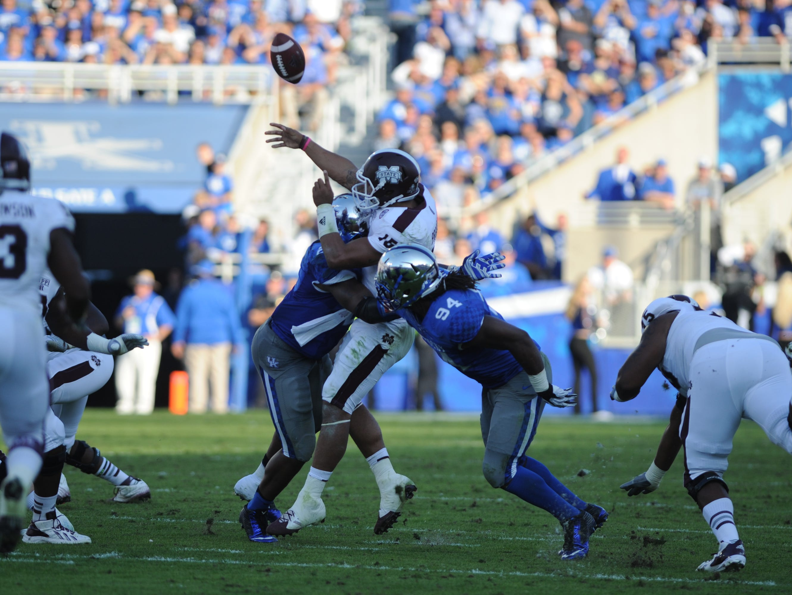 "UK DE Alvin ""Bud"" Dupree hits Miss St QB Dak Prescott as he releases the ball, causing an interception, during the first half of the University of Kentucky football game against Mississippi State in Lexington, Ky. Saturday, October 25, 2014."