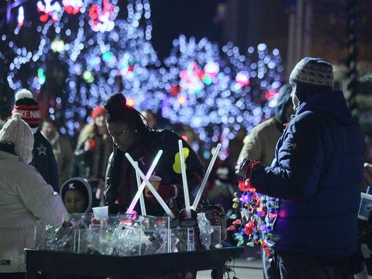 Ian Grant Bruton, right, added to the Light up Louisville ceremony in 2014 by selling some toys,