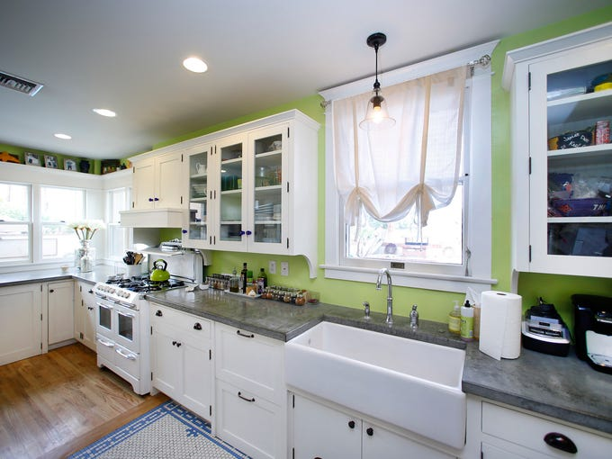 The Kitchen with concrete countertops and handmade