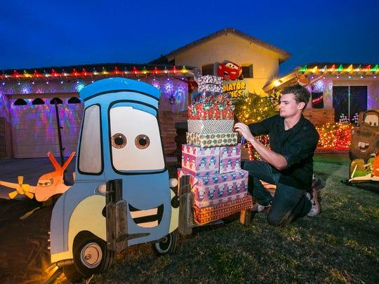 Derek Sirakis puts the finishing touches on his Christmas