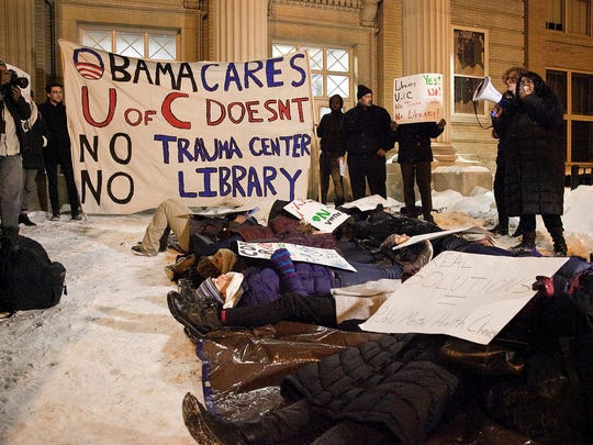 "In this Jan. 13, 2015 file photo, trauma center activists hold a ""die-in"" before a public hearing in Chicago on a University of Chicago proposal to build President Barack Obama's presidential library on public parkland."
