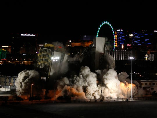 The Clarion hotel and casino is imploded, early Tuesday, Feb. 10, 2015, in Las Vegas.