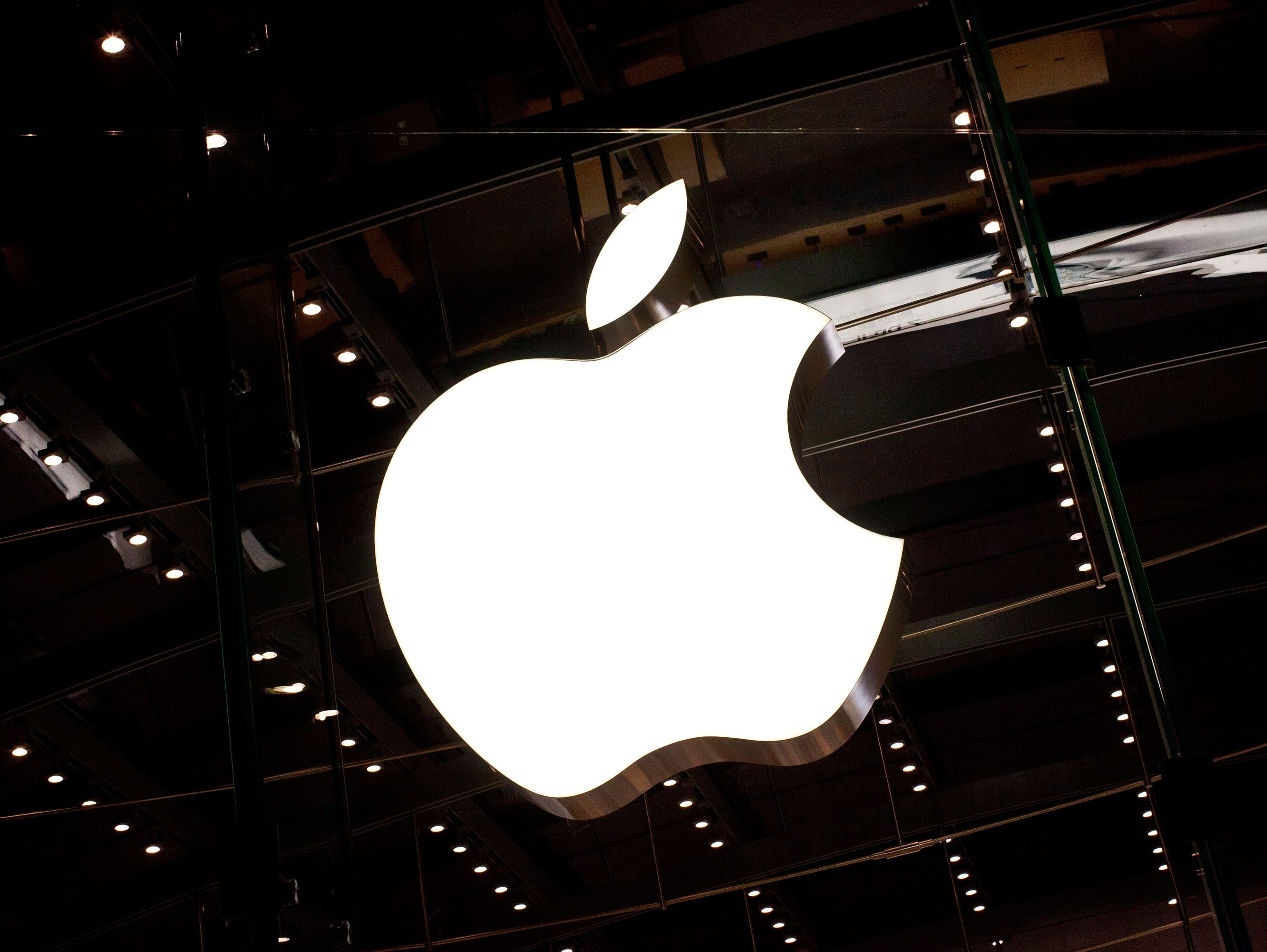 The Apple logo is seen hanging inside the Apple store on West 66th Street in New York City.