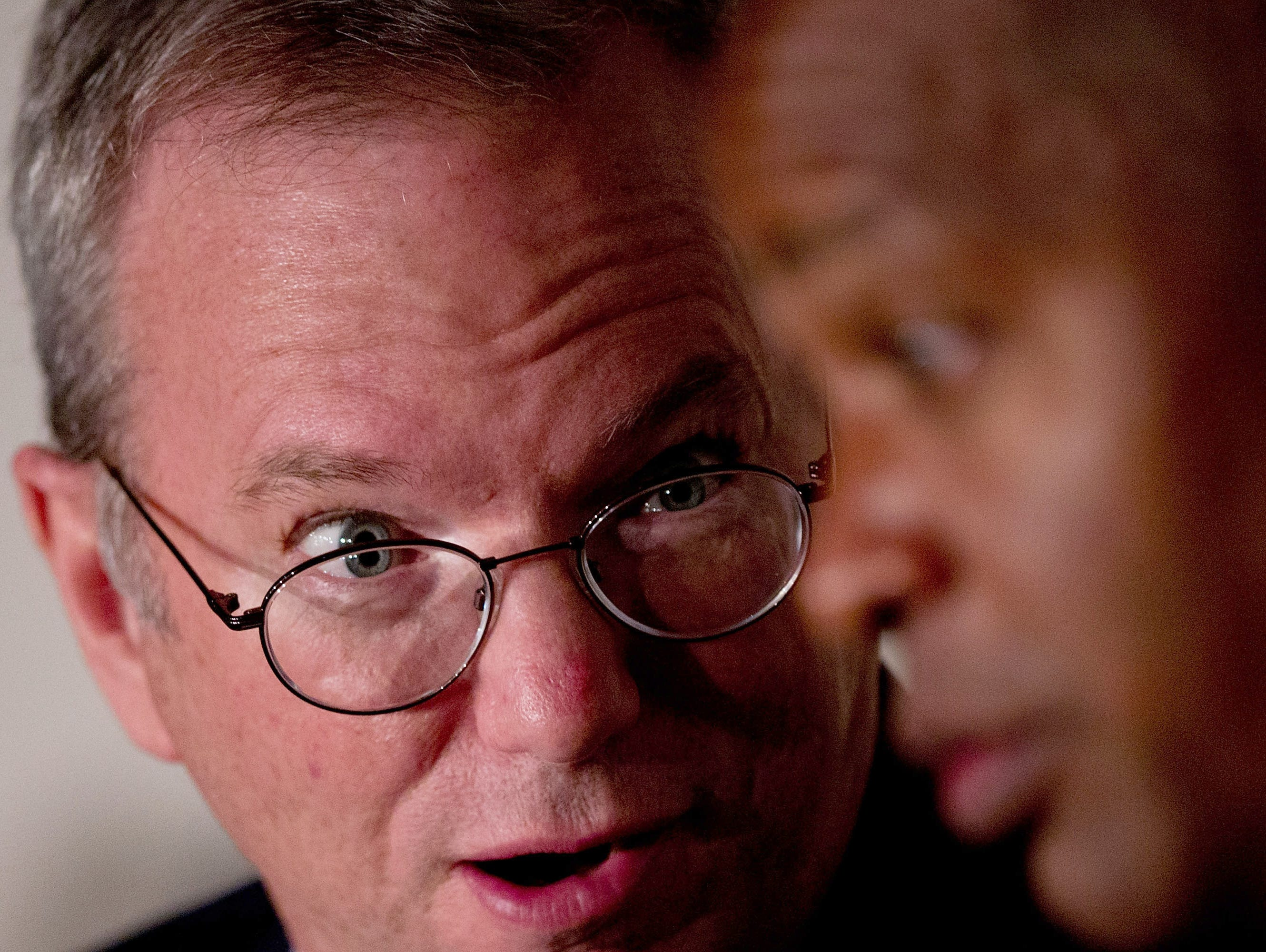 Google Chairman Eric Schmidt, left, speaks with his Senior Vice President of Corporate Development David Durmmond during an advisory council about The Right To Be Forgotten at Casa de America on Sept. 9, 2014, in Madrid, Spain. Google was holding a s