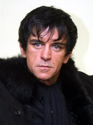 In this file photo photo Steve Strange poses for a photo in London.  Steve Strange, singer with British band Visage and one of the founders of the 1980s' New Romantic style, has died. He was 55. Strange's record label said he died Thursday, in a hospital in the Egyptian Red Sea resort of Sharm el-Sheik, of an apparent heart attack.