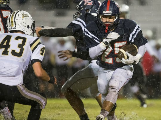 Creek Wood running back Jair Rubio (25) carries the ball during the Red Hawks' 42-0 loss to Springfield on Friday night.