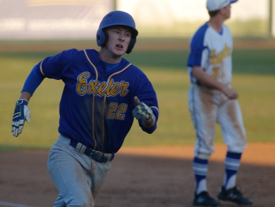 Exeter's Dillon Howell rounds third scoring late in