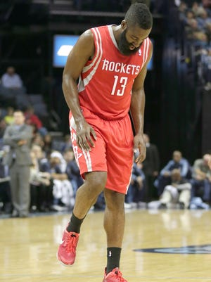 Houston Rockets guard James Harden walks after injuring his knee during the first half of an NBA preseason basketball game against the Memphis Grizzlies in Memphis, Tenn., Friday, Oct. 25, 2013.