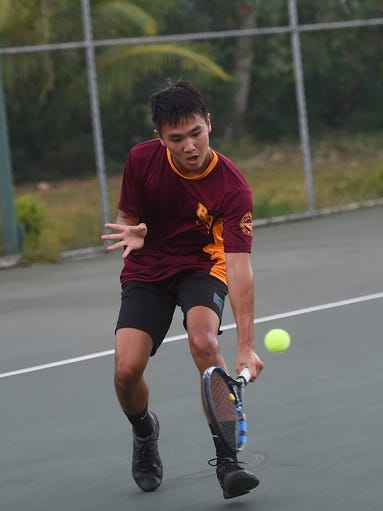 Father Duenas player Camden Camacho, 16, goes low for