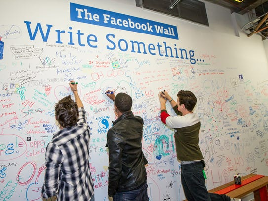 SAN FRANCISCO, CA - JANUARY 14: Zac Efron, Michael B. Jordan and Miles Teller sign a wall at Facebook headquarters on January 14, 2014 in San Francisco, California. (Photo by Kimberly White/Getty Images for FilmDistrict)