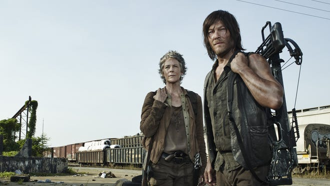 "Melissa McBride as Carol Peletier and Norman Reedus as Daryl Dixon in ""The Walking Dead."""