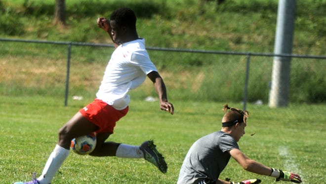 Riverhead's Josh Akinwumi beats the Luray goalkeeper on his way to scoring the game-winning goal Friday in Riverheads' 4-3 Conference 44 championship win.