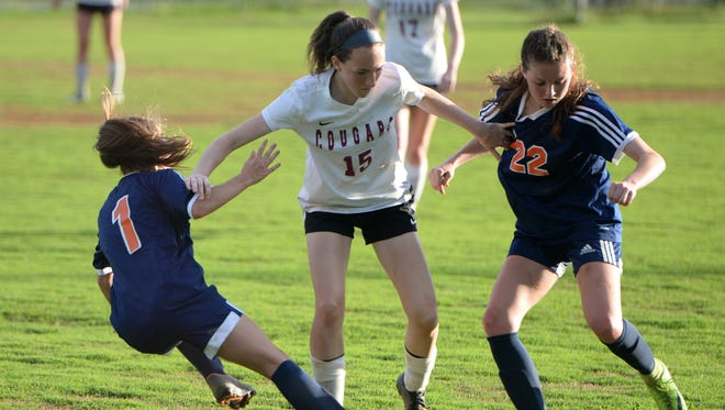 Stuarts Draft's Lyndsay Harris (15) battles Clarke's Zoe Zimmerman (1) and Maeve Lyman (22) for the ball during Wednesday's Region 2B girls soccer semifinal.