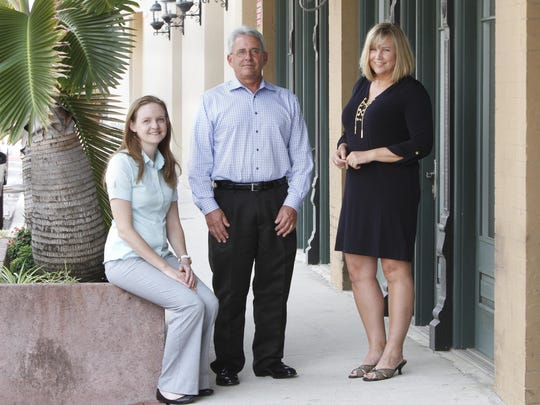 Kellie Clark, Peter Van Buskirk and Angela Fischler, part of engineering and design firm Kimley-Horn and Associates, near their downtown Fort Myers offices Tuesday, August 11.